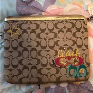 Coach iPhone zip case.